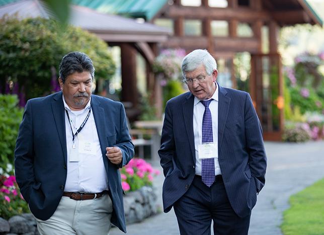 two men walking together.